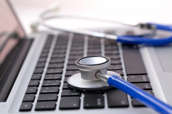 Stethoscope on laptop - Computer repair and maintenance concept